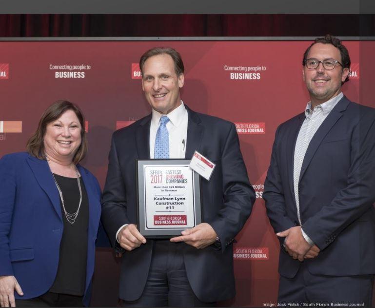 Kaufman Lynn CFO, Doug Simms, Accepts the Award, Ranking 11, from SFBJ President and Publisher, Melanie Dickinson